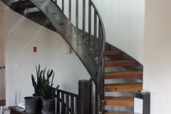 metal curved staircase with wood treads