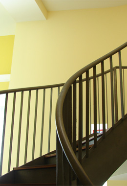 Curved Staircase with Rails on Both Sides