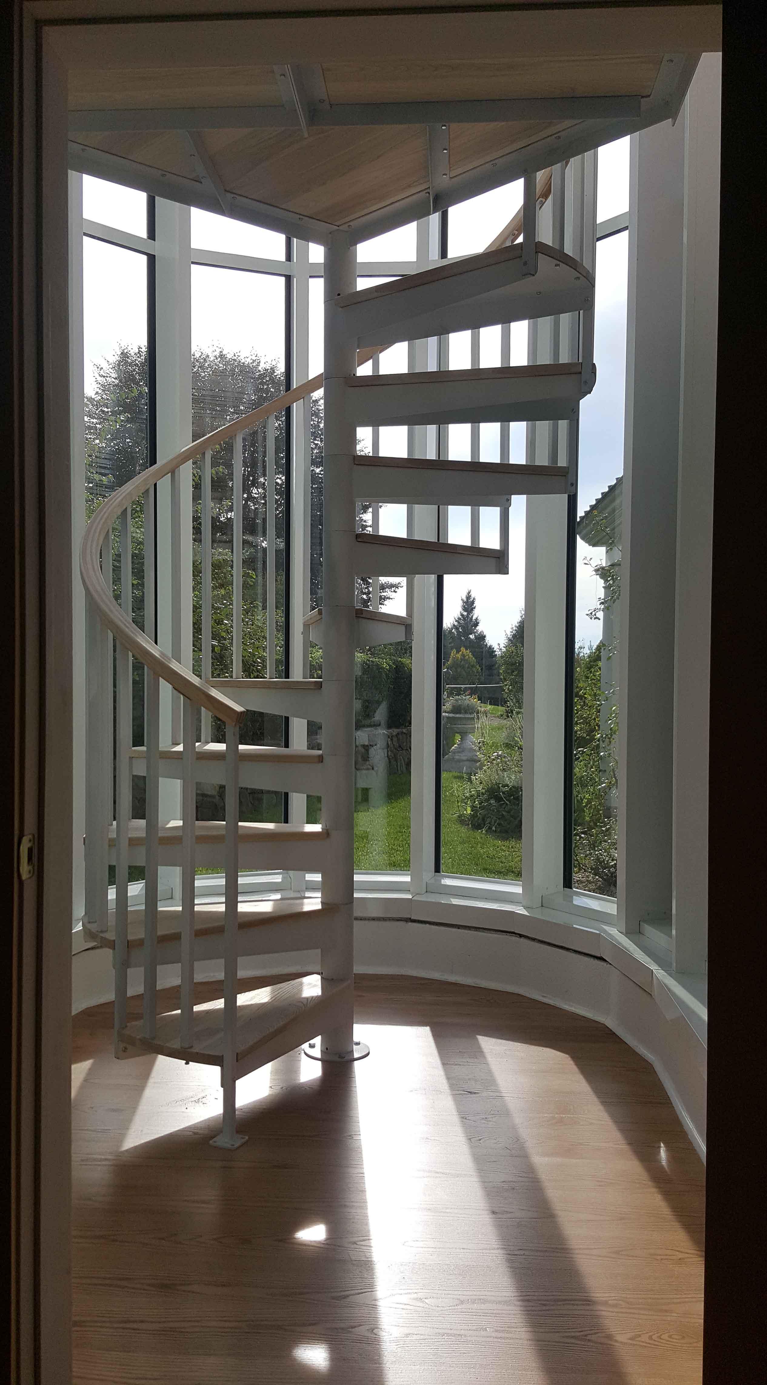 spiral staircase with white ash rail