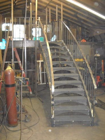 Curved Staircase with Metal Grating Treads During Fabrication