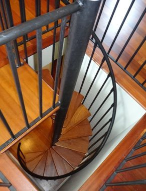 Spiral Staircase with a Mahogany Platform and Mahogany Treads