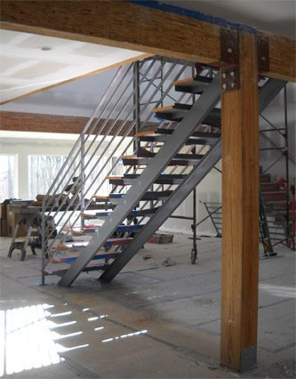 Wood And Metal Straight Single Stringer Staircase