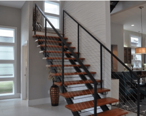 Similarly, The Black Metal Base That Holds Up The Dark Wood Treads Of This Double  Stringer Staircase Boldly Contrasts The Surrounding White Walls.