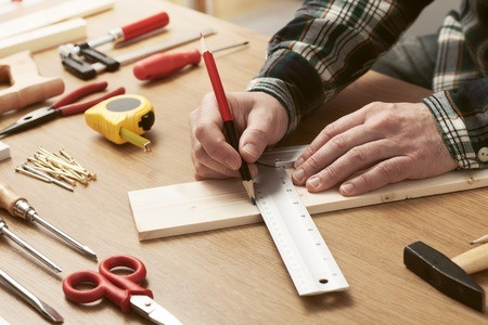 Man Measuring Wood for Project
